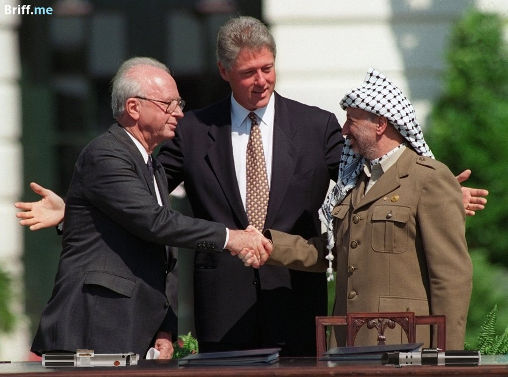 Peace Handshake Clinton Rabin and Arafat laying down Lightsabers from Star Wars - Briff.me