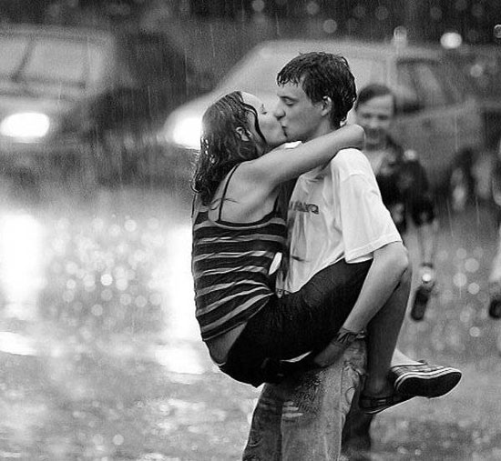 Romantic Kiss for New Year's Eve in the Rain