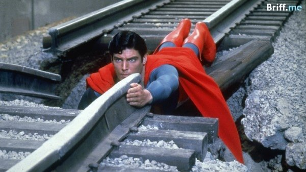 Work Pressure - Superman holding railroad