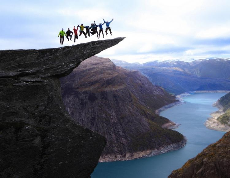 Jumping on the Trolltunga rock in Norway High Place