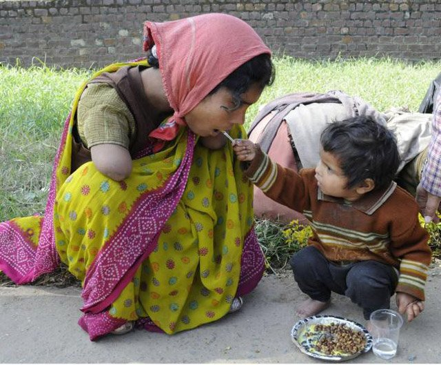 2 Year Old Offering Food To Her Handicapped Mom Human Diversity
