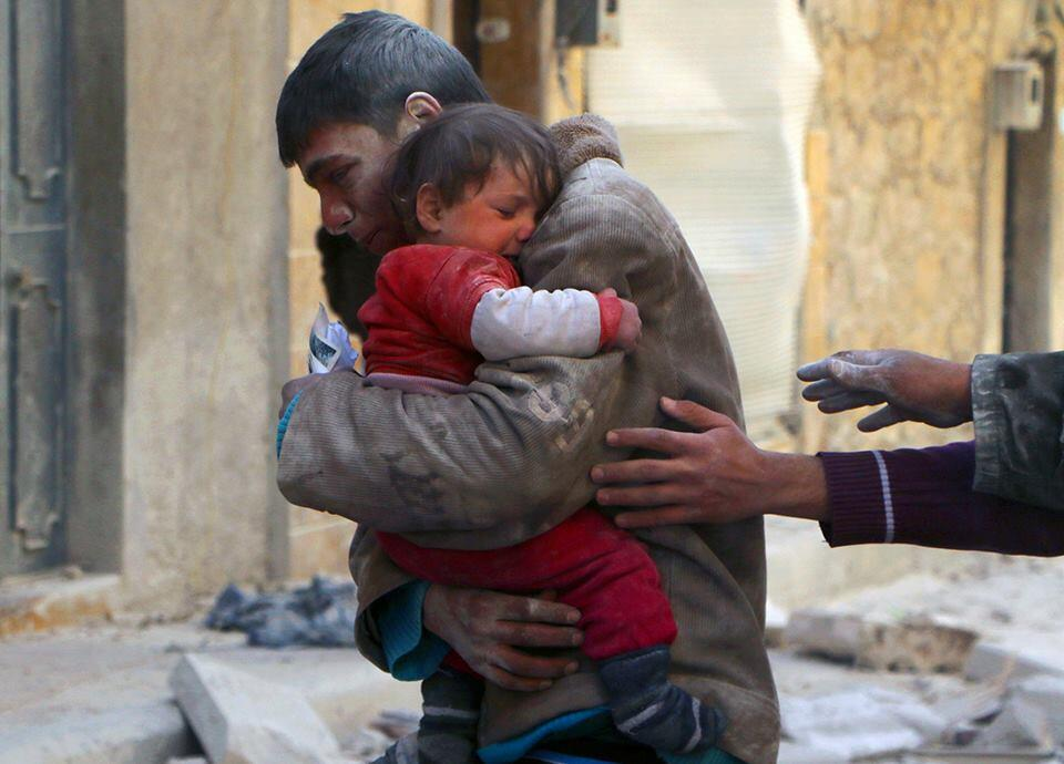 A boy rescues his sister from underneath the rubble of their home in Syria Human Diversity