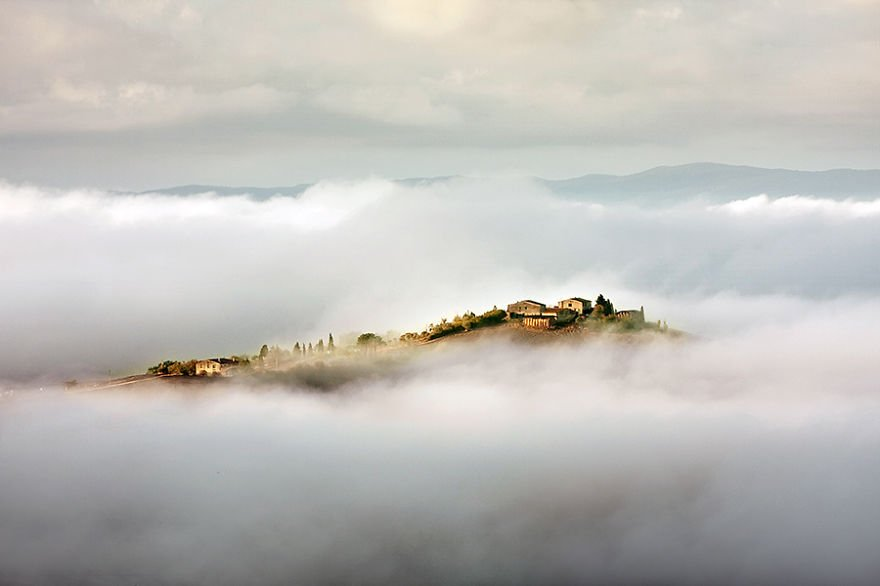 Between clouds and mists Tuscany – Italy Misty Village