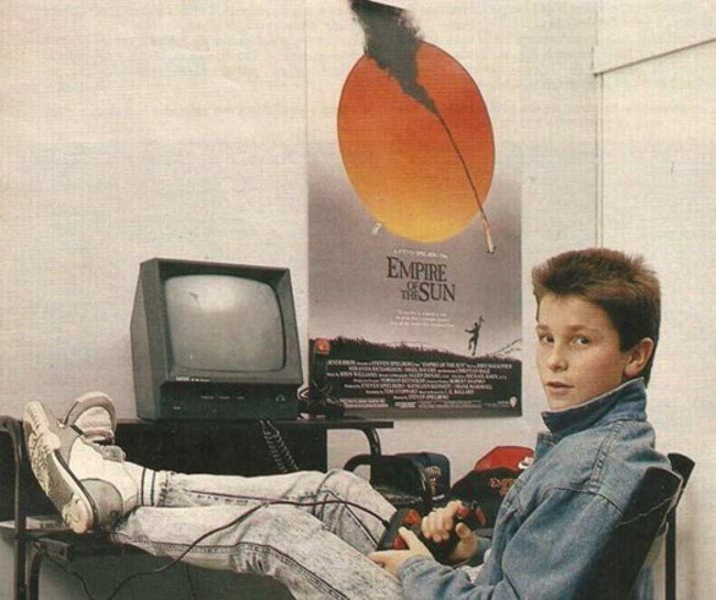 Christian Bale playing with his Amstrad computer. [c. 1984] Young Celebrity