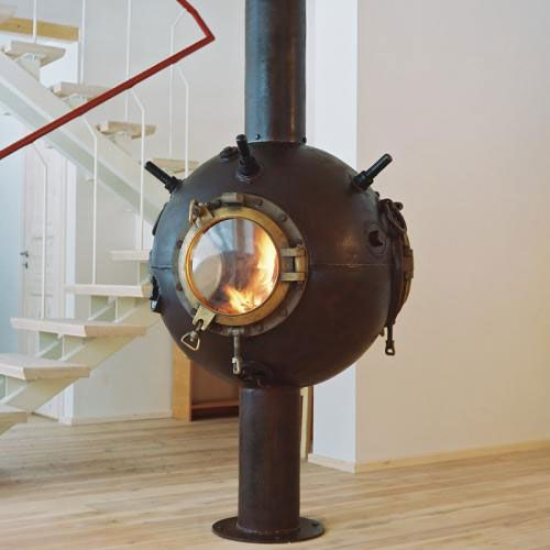 Fireplace made from a decommissioned naval mine Upcycling
