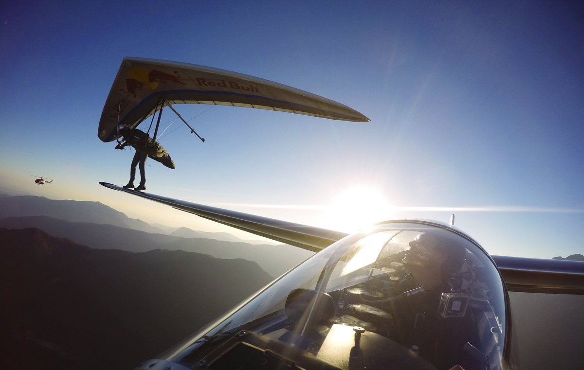 OMG! I am landing on a a Sail plane's Wing Great Photos