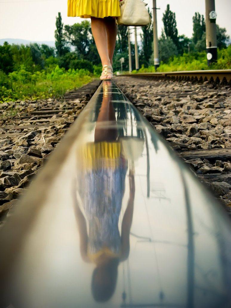 Train Line Walking Water Reflections